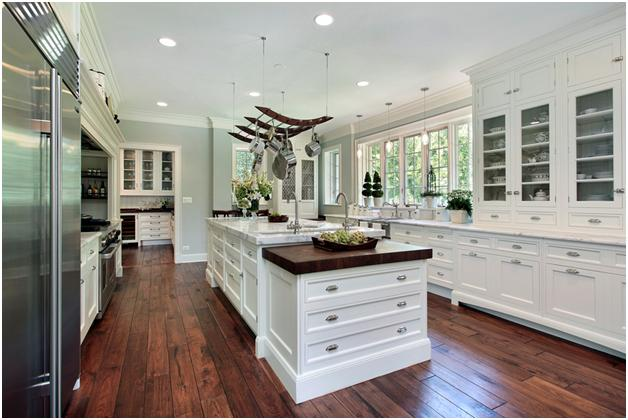Luxury All-White Kitchen with Rustic Flooring by Home Stratosphere