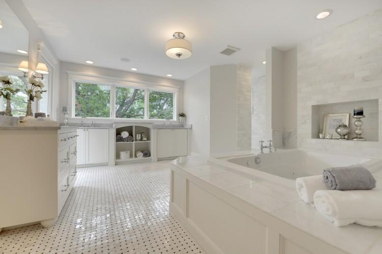 Elegant Transitional Bath with Basket Weave Tile by Divine Custom Home