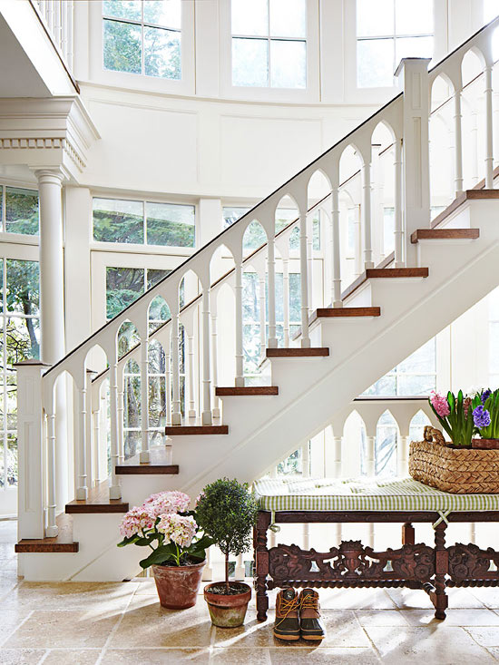 Hampton Summer Home with Spectacular Gothic Styled Rear Staircase Against Wall of Windows by Jack Fhillips Design, Inc.