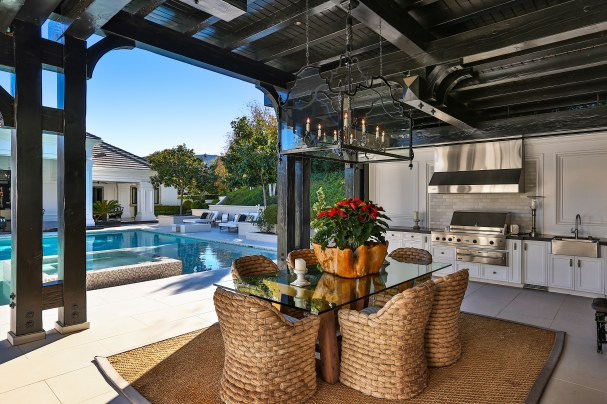 Outdoor Kitchen with Stainless Steel Appliances & Dining