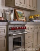 Wolf Dual-Fuel Range Take the Focal Point with Limestone Counter Tops, Butler Bisque Subway Tile Backsplash, Catherine MacFee Interior Design