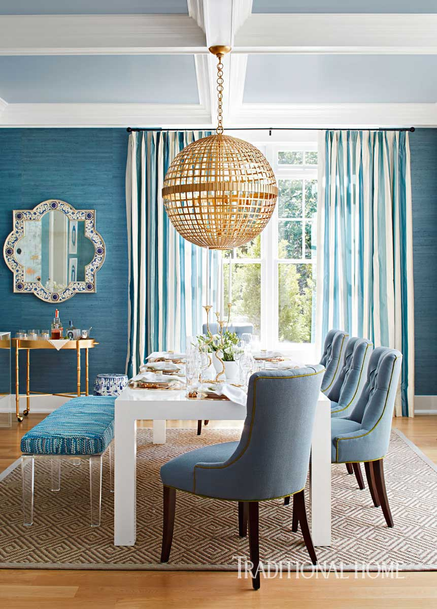 Casual Dining in Style with Walls Clad in Blue Jute Wallpaper, Vintage Table and Gilded Orb Lighting Fixture by Circa Lighting. Barbara Page