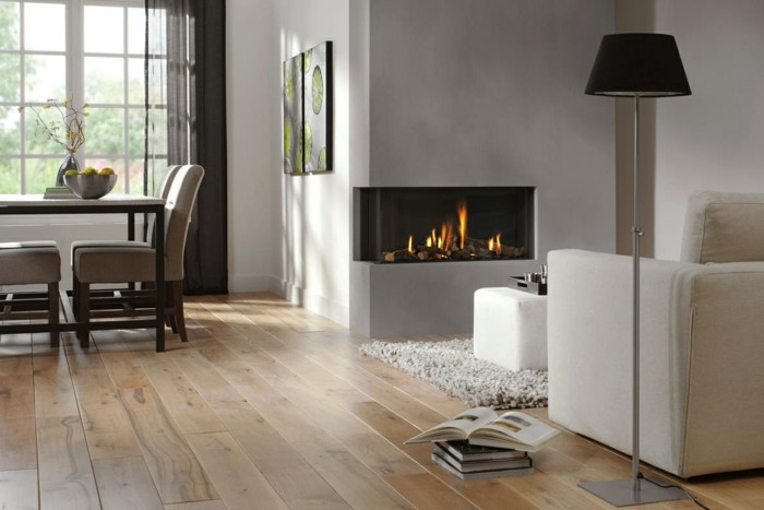 flooring-trends-solid-wood-engineered-lvts-open-floor-plan-w-fireplace-and-hardwood-floors-freshdesignpedia